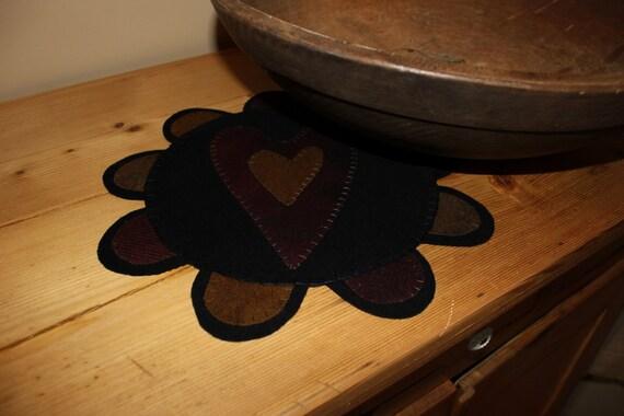 Primitive heart wool penny rug