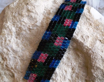 Peyote stitch bracelet in blue, black, green and red