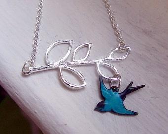 branch leaves with patina blue bird bracelet