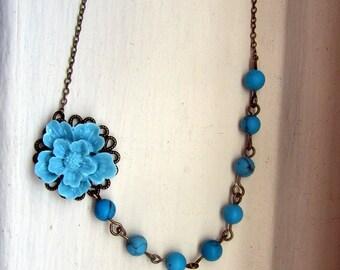 Blue sakura with turquoised stone beads antique bronze necklace