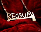 REDRUM horror necklace with axe inspired by The Shining in silver stainless steel - horror jewelry