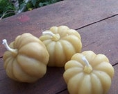 Three sweet little beeswax pumpkin candles