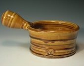reserved for Justin       SOUP BOWL, side handled with honey gold glaze (III 25)