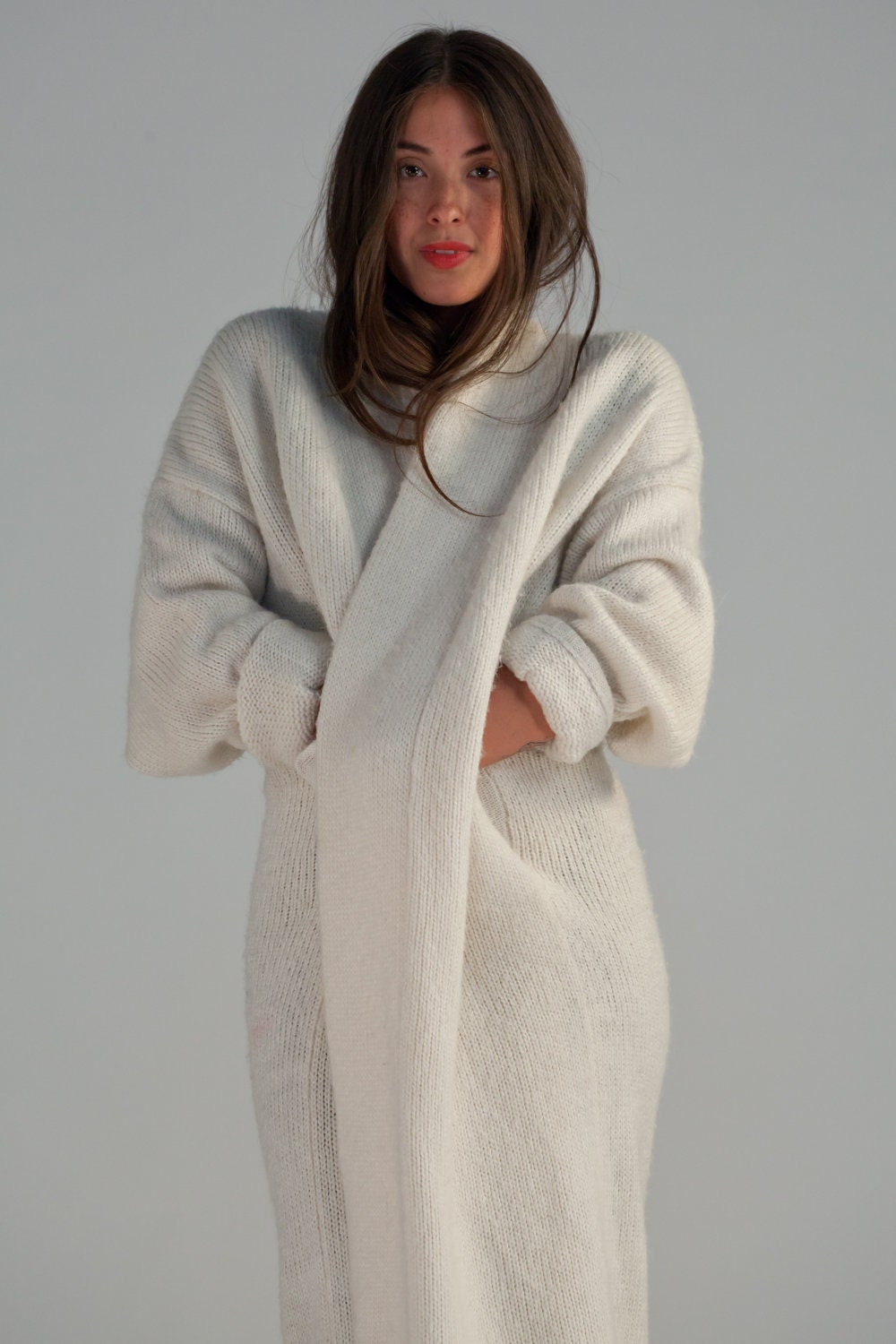 A long sweater coat is the ideal outer layer for wear outside during the in between seasons of spring and fall, those cool summer nights down by the ocean, and as an indoor garment on a frigid winter day.