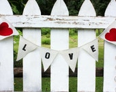 Love banner with red fabric hearts as seen in Gala Wedding Magzine