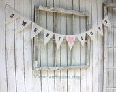Sweet Love banner with navy blue font and pink fabric heart