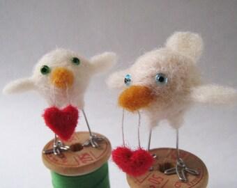 Cupid, needle felted bird fiber sculpture with heart