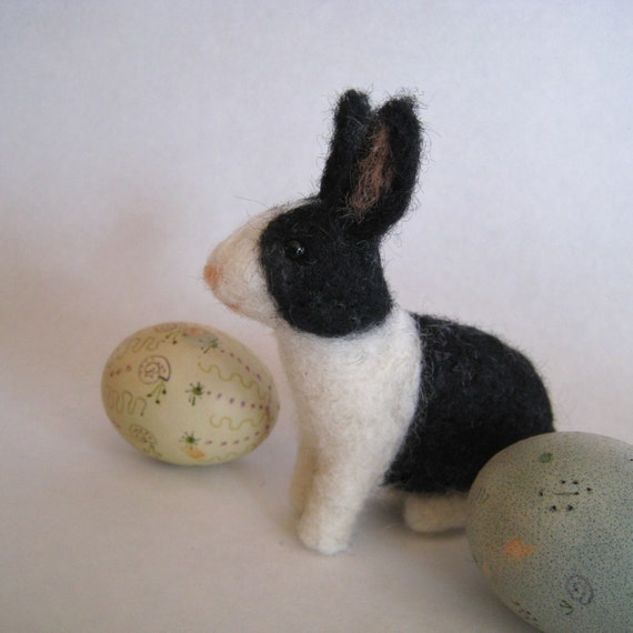 A bunny in black and white, needle felted rabbit animal sculpture