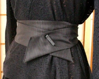 under 50, black wool belt with leather pin Japanese inspirited