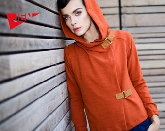 Terra cotta orange hood french terry sweater with camel leather claps