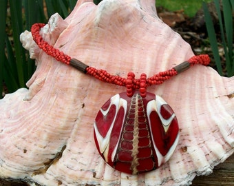Seashell Encased in Acrylic Accented in Red With Red Beaded Necklace