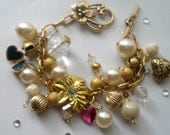 Gold charm bracelet with 3 heart lockets crystals and orchids Romance and bling