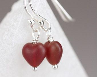 red glass heart earrings. cinnamon