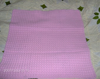 pink crocheted baby afgan