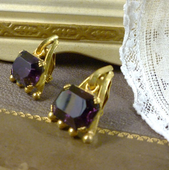 baroque styled deep amethyst coloured rhinestone and brass earrings