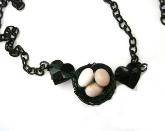 Bird Nest Pendant Necklace departure from the nest on black chain  Beach Stone Black necklace