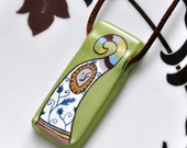 Colourful character handpainted on glass pendant