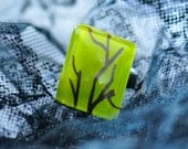 Green glass ring with tree branch drawing