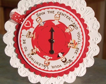 "Fun Interactive Spinner Card - 5"" x 5 1/4"" Scallop Circle - Spin the Center and You'll See Who Your Valentine Will Be"