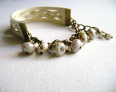 Loyal - Beautiful romantic style ivory faux leather and green lilac glass bead bracelet