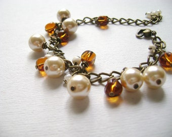 Flying away  -  Vintage inspired whimsical burnt orange and champagne beads bracelet