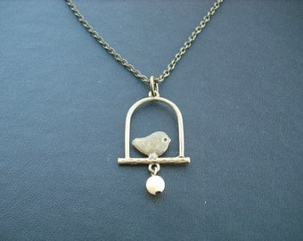 bird on a swing necklace - antique brass
