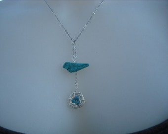 turquoise bird and a nest lariat - white gold plated chain
