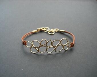 matte gold long multi teardrop bracelet