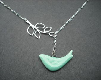 matte white gold five leaf branch and porcelain teal green bird lariat