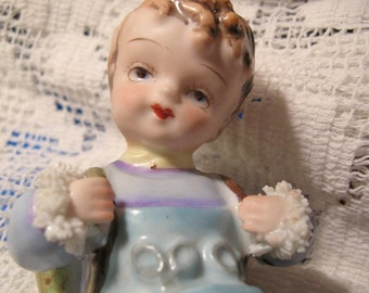 Vintage European-Looking Porcelain Figurine, Time Raveler