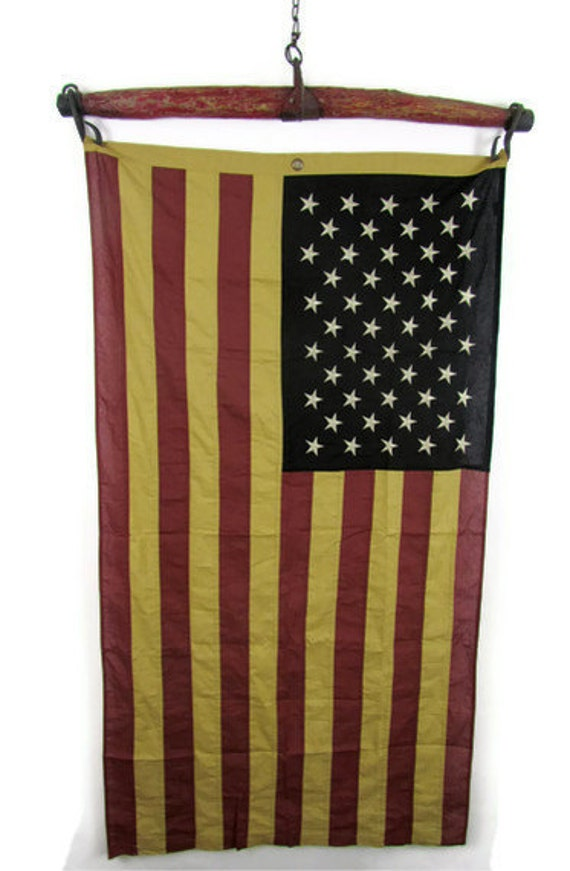 Old American flag on salvaged red  horse yoke