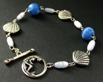 Mermaid Bracelet in Silver with Seashell Beads and Blue Silk. Handmade Bracelet.