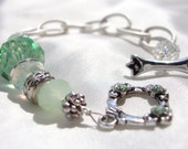 Green crystal bracelet with silver chain and toggle clasp