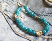 Blue Bracelet glass beads and metal flower beads Med