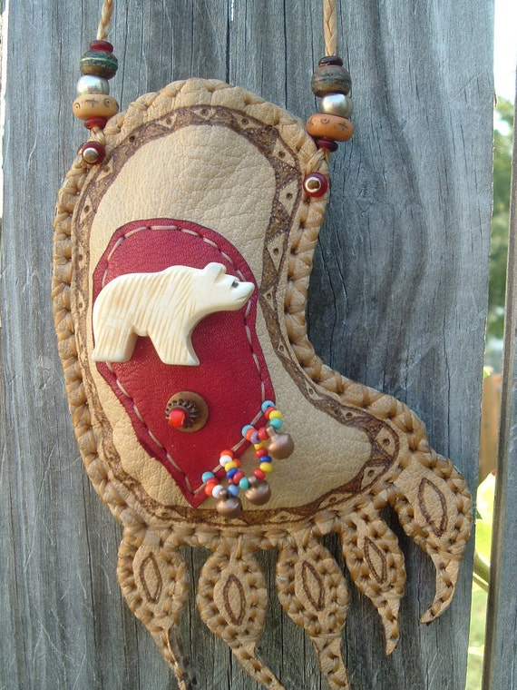 Make a statement with this beautiful medicine bag bear paw design
