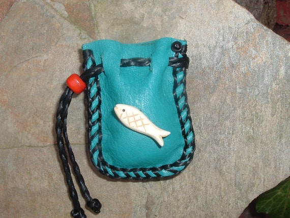 Small Turquoise Colored Medicine Bag with a hand carved Bone Fish Fetish on the front
