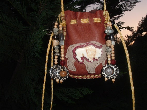 This is(((( reserve for JULIE JAY)))) please don't purchase Deerskin Medicine Bag with a Hand Carved Bone Buffalo Fetish Bead On the front