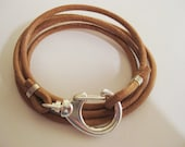 Tan leather wrap around bracelet with stunning large silver clasp