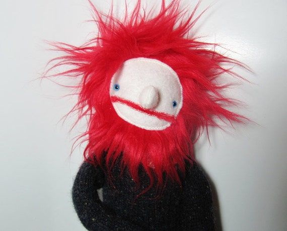 Man fabric doll with black sweater and red hair