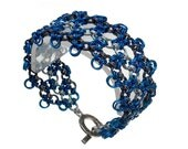 Blue Ice Chainmaille Bracelet with electric blue, black ice, and matte silver hexagon mesh patterning