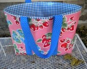 Large oilcloth tote bag with retro strawberries on bubble gum pink