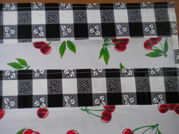 Reversible oilcloth placemats in a retro cherries pattern and black cafe check