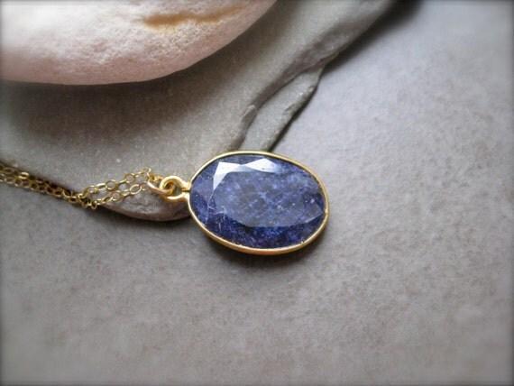 Blue Sapphire Pendant framed in Gold