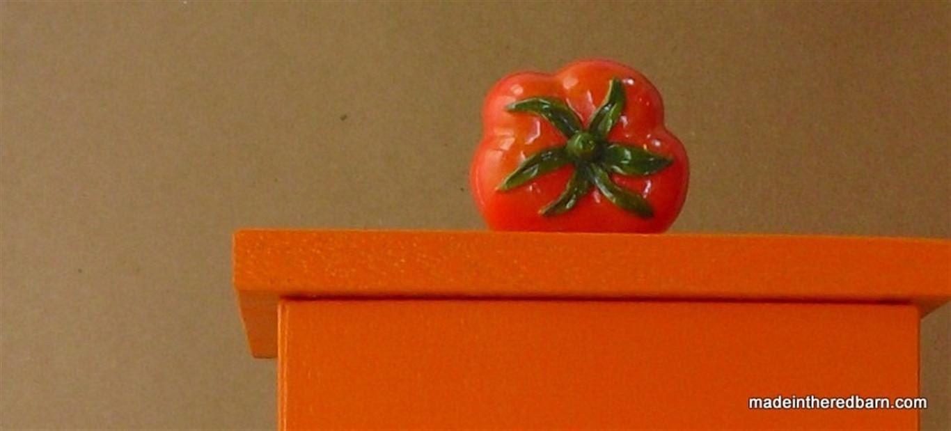 Mid century modern orange towel house with tomato knob last