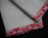 crisp white pillowcases with delicate pink crocheted trim - pair