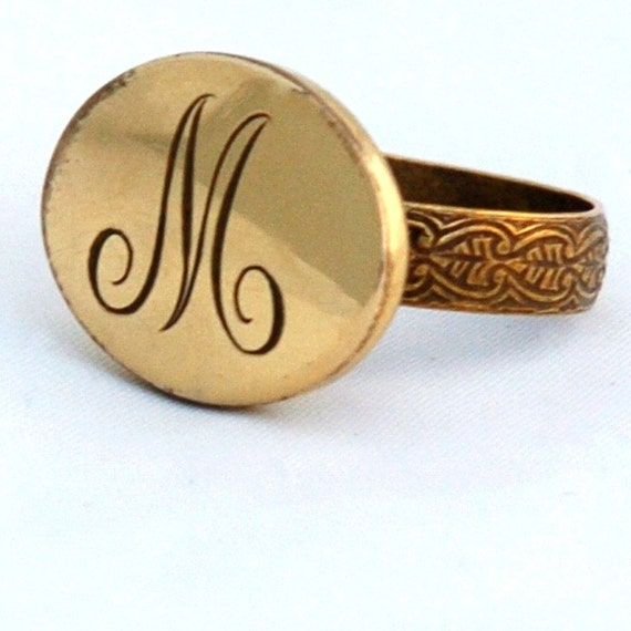M Letter In Ring oval ring with ...