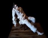 Mixed media sculpture (clay, fabric, wood).Traditional italian character - Pulcinella, Drama