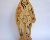 A little wooden tattooed sailor in love III