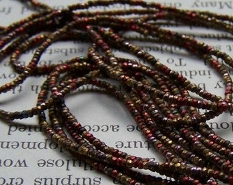 Antique French metal bead  strand copper rust color muted blend round
