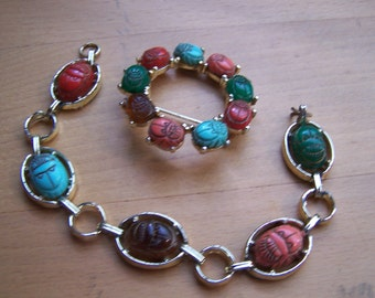 Vintage Egyptian revival bracelet and broach  Scarab stone cabochons  Gold tone links